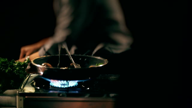 2 Shots of Chef cooking over high heat in pan.