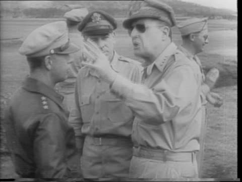 vídeos de stock, filmes e b-roll de shots of crowds of australian troops outdoors / soldiers boarding transport ships / boats in water / pan of air field with planes lined up /... - general macarthur