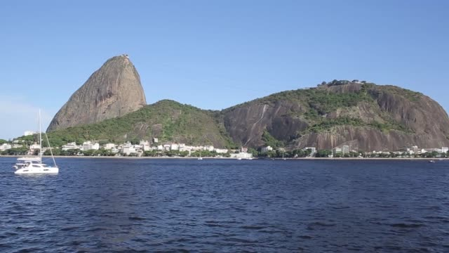 Shots of cruise ships sail boats and yachts on the Guanabara Bay near Rio de Janeiro Brazil Wideshots of Sugarloaf Mountain a peak situated in Rio de...
