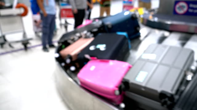 5 Shots of Defocused Baggage Claim in Airport when Arrival