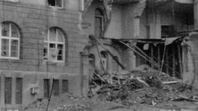 vídeos de stock, filmes e b-roll de shots of destroyed buildings in breisach / allied bombing damage during wwii on november 25, 1944 in breisach, germany - forças aliadas