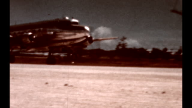 shots of douglas dc4's taking off and landing there is one section where a dc3 takes off / the difference is the dc4 has two engines on each side and... - 1945 stock videos & royalty-free footage