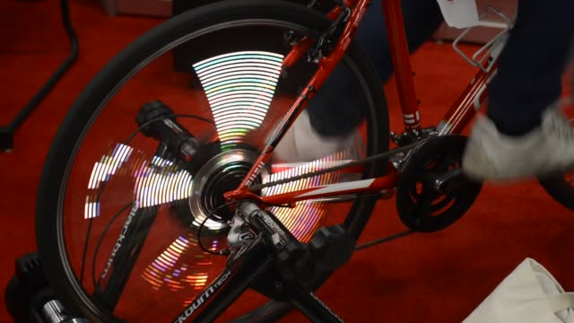 shots of exhibitions inside the south by southwest interactive festival in austin texas us visitors and guests interact a bicycle that displays... - speichen stock-videos und b-roll-filmmaterial