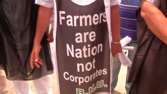 shots of farmers protesting on the road. they have gathered to oppose the centre's bill to replace farm ordinance. members of bhartiya kisan union... - farm stock videos & royalty-free footage