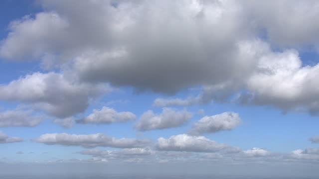shots of fast moving white fluffy clouds against blue sky on february 22, 2014 in london. - blue stock videos & royalty-free footage