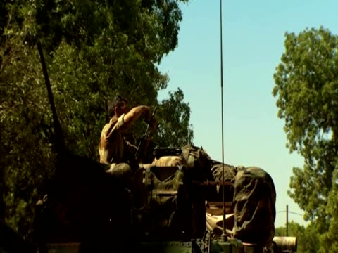shots of french soldiers cleaning their weapons during the conflict with islamist militants in mali jan 13 - 煙草製品点の映像素材/bロール