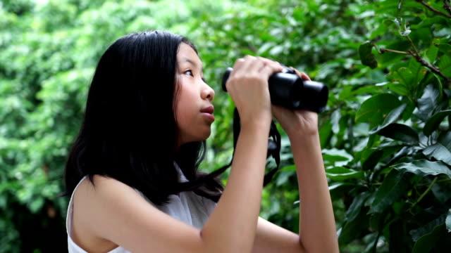 3 shots of girl seen through binoculars - meteorology stock videos & royalty-free footage