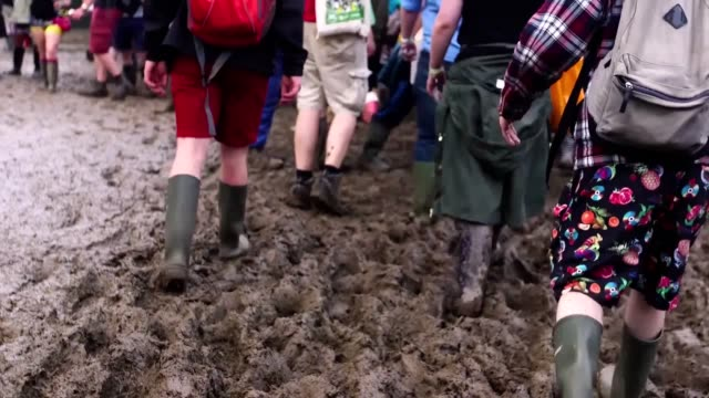 shots of glastonbury festival in 2016 and 2017 as music lovers prepare to return to worthy farm after the fallow year of 2018 - mud stock videos & royalty-free footage