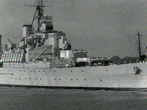 Shots of HMS Gambia preparing to dock at Portsmouth docks The ship is carrying Haile Selassie the Emperor of Ethiopia for his first state visit to...