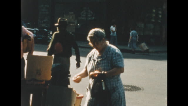 shots of jewish people in new york's lower east side examining fruit in a fruit stand. watermelon visible. a woman with grocery cart walking down the... - judaism stock videos & royalty-free footage
