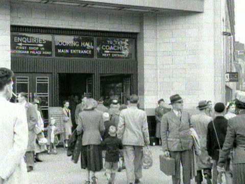 shots of large crowds at a busy victoria coach station as people prepare to leave london for the bank holiday weekend. 1954. - number of people stock videos & royalty-free footage