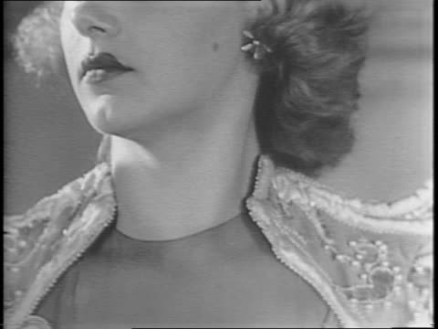 vídeos de stock e filmes b-roll de shots of maybritt irene johnson trying on a formal gown with the help of another woman / close up and slow tilt shots of may with dress on that was... - enfeites para a cabeça