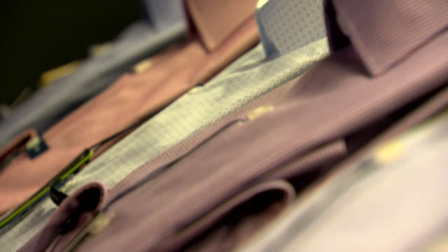 shots of men's formal shirts on a shop display rack - gingham stock videos & royalty-free footage