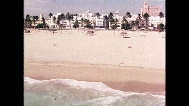 shots of miami beach skyline and sunbathers; 1980 - miami stock videos & royalty-free footage