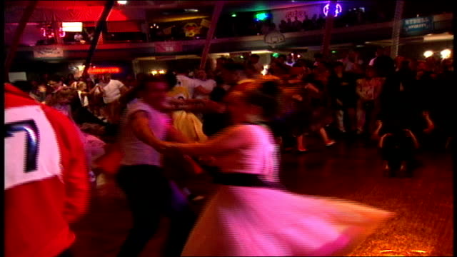 Shots of People Dancing in 50s Attire