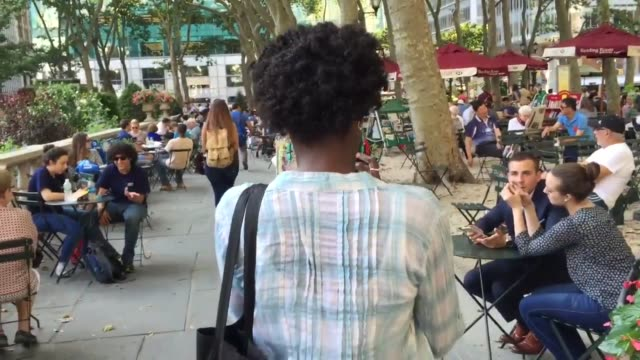 shots of people playing pokemon go in bryant park with interviews. - pokémon stock videos & royalty-free footage