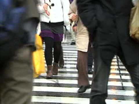 faces ms shots of people walking across the street you can see the zebra lines of the crosswalk hot from the waist down the ground is damp from the... - waist stock videos & royalty-free footage