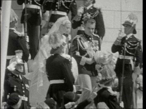 shots of prince rainier / grace kelly religious wedding ceremony:; monaco: ext gv cathedral of our lady immaculate man along bishop gilles barthe and... - religious dress stock videos & royalty-free footage