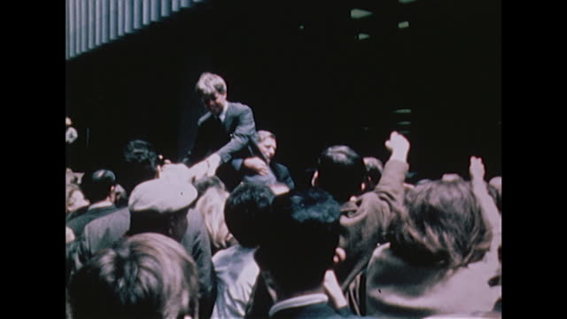 Shots of Robert Kennedy greeting crowds during his presidential election campaign