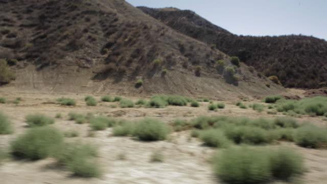 pov shots of rocky mountains while driving down along desert road / santa clarita, california, united states - santa clarita stock videos & royalty-free footage