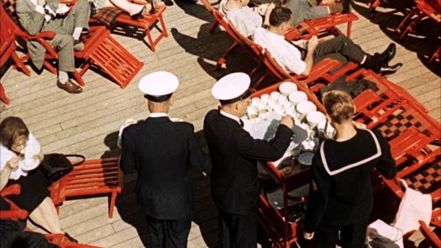 ms shots of shipboard activities aboard cruise ship, deck loungers - 船体点の映像素材/bロール