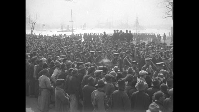 vs shots of soldiers marching through a crowded street flanked by hundreds of civilians / vs and pan right marchers with backed up traffic beyond /... - 1910 stock videos & royalty-free footage