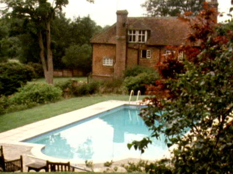 vídeos de stock e filmes b-roll de shots of the 15th century farmhouse owned by the former rolling stone brian jones and the swimming pool in which his body was found in july 1969. - rolling stones