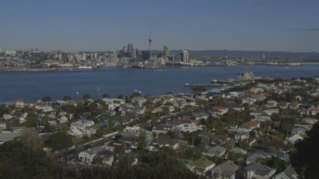 shots of the city, ferry, suburbs, and daily life in auckland, new zealand on july 20, 2015. shots: wide shot of ferries in the water, extreme wide... - auckland ferry stock videos & royalty-free footage