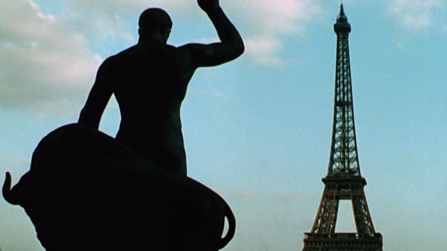 shots of the city of paris including the eiffel tower, moulin rouge, cabarets, and notre damme - 1970 1979 stock videos & royalty-free footage