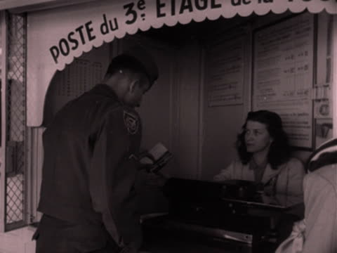 vidéos et rushes de shots of the concession stands and tourists taking in the views from the top of the eiffel tower. 1952. - poste