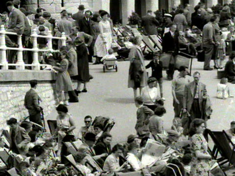 shots of the crowded promenade and beach at bournemouth 1954 - outdoor chair stock videos & royalty-free footage