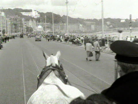 shots of the horse drawn trams on the seafront at douglas on the isle of man. 1954. - isle of man stock videos & royalty-free footage