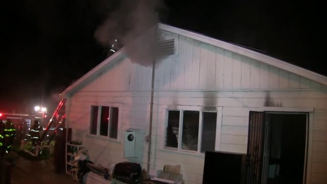 shots of the house fire, firefighters, and soundbite from sdfd pio joe amador at 2:55. - fire protection suit stock videos & royalty-free footage