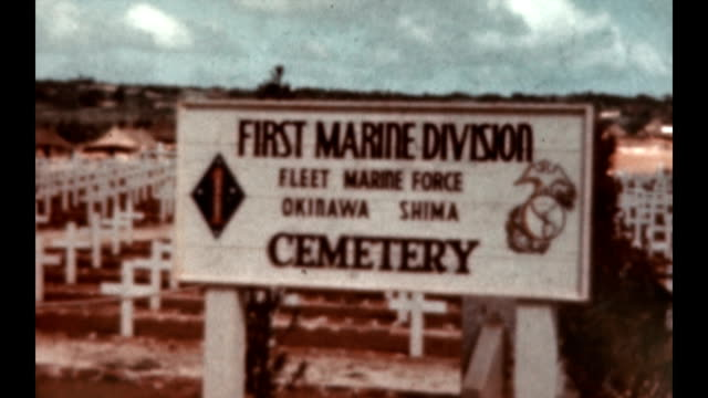 shots of the ie shima airfield and the first marine division cemetery at the end of wwii / fleet marine force okisawa shima - 戦後点の映像素材/bロール
