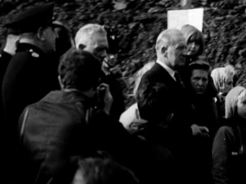 shots of the queen and prince philip visiting aberfan following the coal tip disaster october 1966 - 1966 stock videos & royalty-free footage