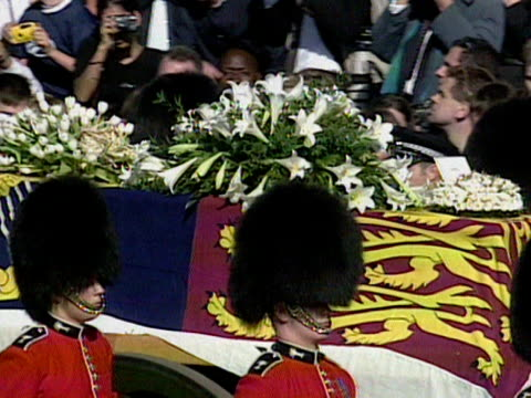 Shots of the white wreaths on top of Princess Diana's coffin as the funeral cortege makes it way to Westminster Abbey 06 Sep 97
