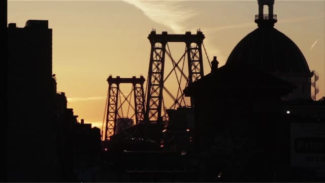 shots of the williamsburg bridge from the marcy ave subway station platform in brooklyn, new york, the silhouette of the williamsburg bridge is seen... - williamsburg bridge stock videos & royalty-free footage