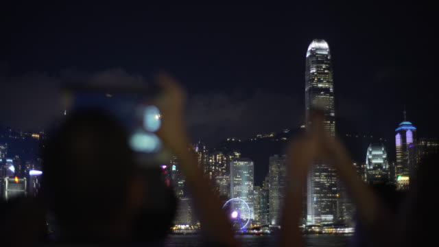 Shots of tourists taking photos at Victoria Harbor
