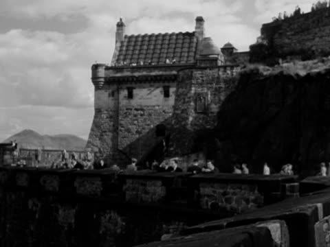 Shots of tourists walking along the ramparts of Edinburgh Castle September 1950