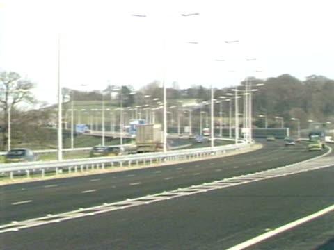 shots of traffic moving along the m25 motorway. january 1984. - m25 video stock e b–roll