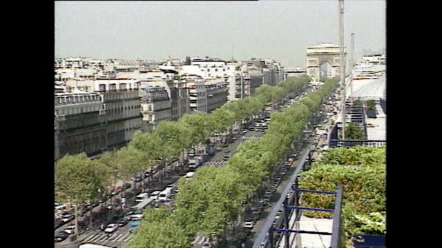 ha shots of traffic on rue de l'arc-de-triomphe; 1989 - arc de triomphe paris stock videos & royalty-free footage