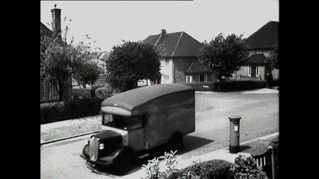 stockvideo's en b-roll-footage met b&w shots of uk roads with cars and delivery vans - brievenbus huis
