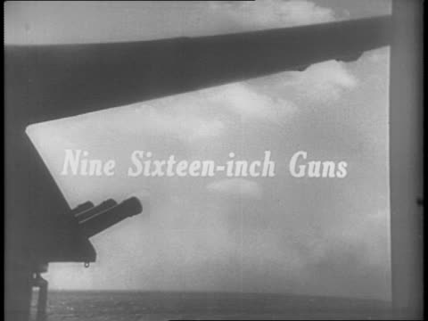 shots of uss north carolina navy battleships at sea / shots of navy sailors loading the ammunition for sixteen inch guns aboard battleship / shots of... - ammunition stock videos and b-roll footage