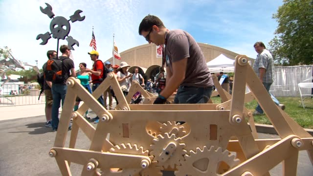 shots of various inventions being demonstrated at the bay area makers faire a wide shot of the cyber spider being operated by its inventor matthew... - erfindung stock-videos und b-roll-filmmaterial