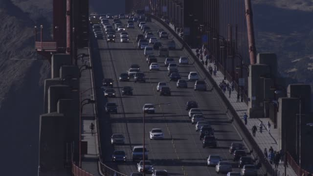 shots of vehicle traffic on the golden gate bridge in san francisco, california, wide shots of cars driving across the golden gate bridge in san... - golden gate bridge stock videos & royalty-free footage