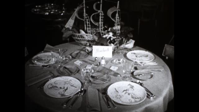 shots of well set up table with plates utensils glasses and reservation card with the word nevocle another set up table with flowers and a... - card table stock videos & royalty-free footage