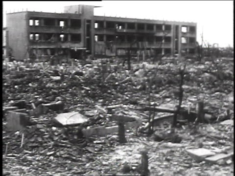 shots of wreckage / damaged buildings / people working among the rubble - atomic bomb stock videos & royalty-free footage