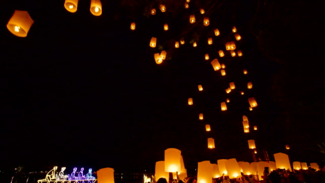 2 shots of yi peng - loi kra thong festival in chiang mai, thailand. - paper lantern stock videos and b-roll footage