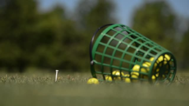 Shots pan across a golf green at Cherry Creek golf course in Riverhead Long Island New York Shots of golfers practicing on a driving range at Cherry...