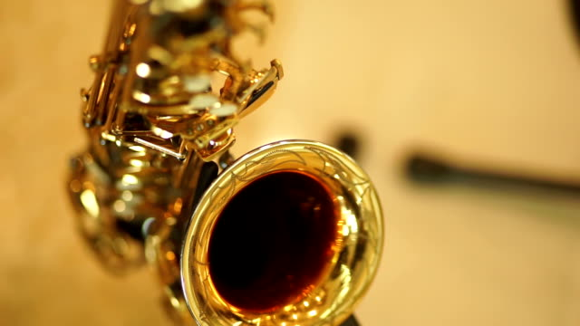 2 shots saxophone standing on stage. - alto saxophone stock videos and b-roll footage